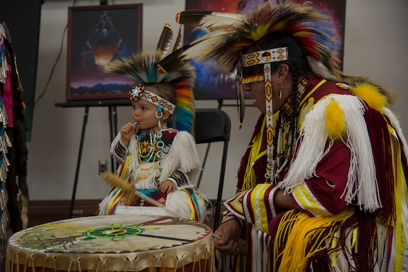 "Brian ""Blue Jay"" Littlejohn, of the Cherokee nation, plays a drum with his grandson Kyler during a Native American Heritage Month Celebration, Nov. 21, 2019, at MacDill Air Force Base, Fla.  Littlejohn performed traditional Cherokee dances during the celebration."