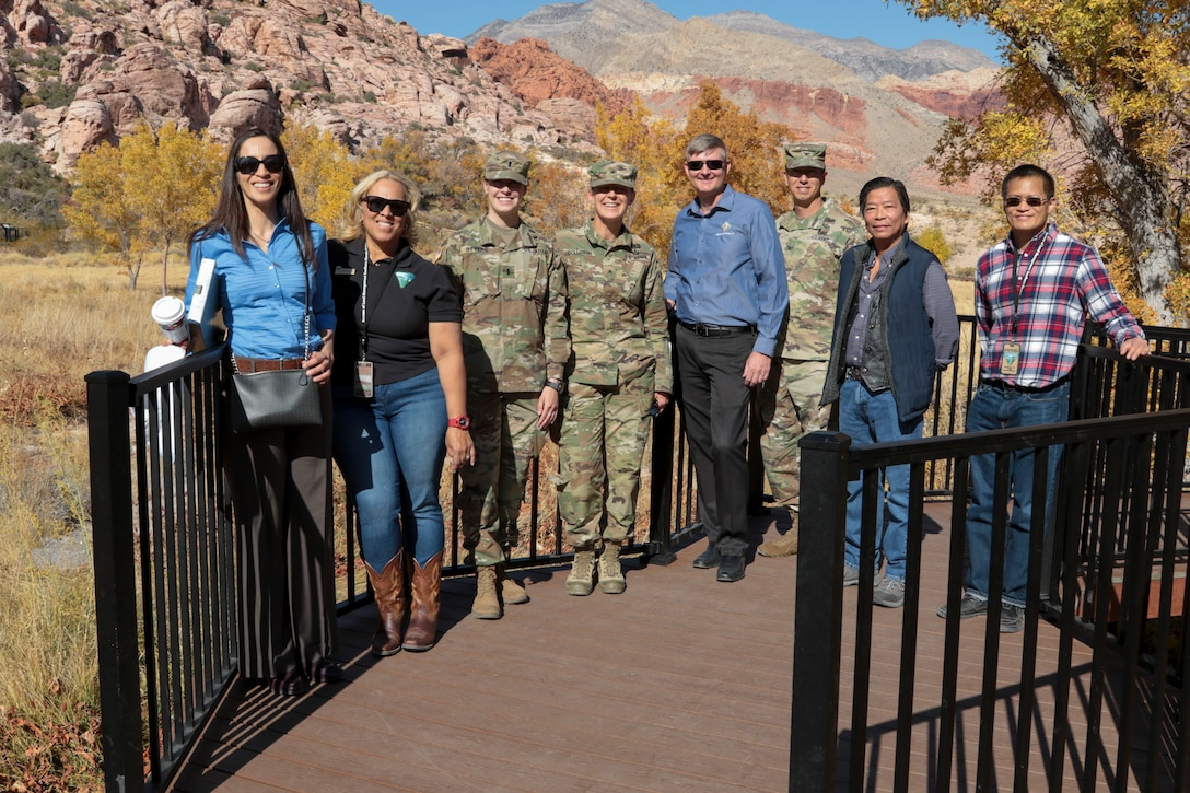 Leaders with the U.S. Army Corps of Engineers South Pacific Division, Los Angeles District and the Bureau of Land Management officially reopened Red Spring boardwalk Nov. 8. Roughly a half-mile in length ... the accessible boardwalk is in the Calico Basin of the Red Rock Canyon National Conservation Area, Nev.  From left to right, Claudia Garcia, project manager with the LA District's Arizona-Nevada Area Office; Catrina Williams, field manager for the BLM's Red Rock/Sloan Field Office;  1st Lt. Kara Styers, aide-de-camp to the SPD commander;  Brig. Gen. Kim Colloton, SPD commander; Brian Christ, vice president S&B Christ Consulting, LLC, of Las Vegas; Col. Aaron Barta, District commander; Viet Tran, project engineer for the district's Las Vegas Resident Office; and Raymond Tsui, civil engineer with BLM's Southern Nevada District Office.