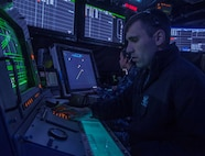 """IMAGE: ATLANTIC OCEAN -- Air Traffic Controller 3rd Class Brandan Cloud, foreground, and Air Traffic Controller 1st Class Laura Garcia track air traffic in the vicinity of the aircraft carrier USS Harry S. Truman (CVN 75). More than 150 technical experts from Naval Surface Warfare Center (NSWC) Dahlgren Division, NSWC Philadelphia Division, and NSWC Indian Head Explosive Ordnance Disposal Technology Division attended a Nov. 8, 2019 event -- called Dahlgren Innovation Day, for discussions and demonstrations about technologies that will impact the current and future fleet, including the Truman and its battle group. """"We saw demonstrations that involved artificial intelligence, machine learning, sensors, quantum-based computing, cloud-native technologies, automation, blockchain, and other advanced capabilities that will have a dramatic impact on our development of innovative solutions for the fleet,"""" said Laura Martin, program manager for the Information Technology Hyper Convergence - Hybrid Cloud Team at NSWC Dahlgren Division.  (U.S. Navy photo by Mass Communication Specialist Seaman Emily M. Blair)"""