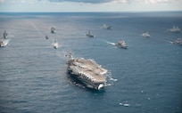 IMAGE: CORAL SEA (July 11, 2019) The U.S. Navy Nimitz-class aircraft carrier USS Ronald Reagan (CVN 76) leads a formation of 17 other ships from the U.S. Navy, U.S. Coast Guard, Royal Australian Navy, Royal Canadian Navy and Japan Maritime Self-Defense Force (JMSDF) during Talisman Sabre 2019. Talisman Sabre 2019 illustrates the closeness of the Australian and U.S. alliance and the strength of the military-to-military relationship. This is the eighth iteration of this exercise. (U.S. Navy photo by Mass Communication Specialist 3rd Class Jason Tarleton/Released)