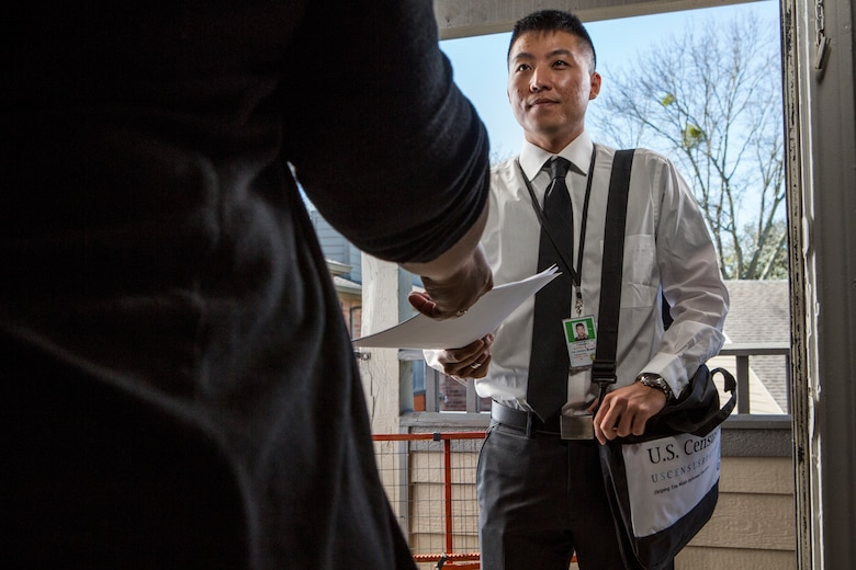 Man handing papers to someone.