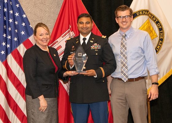 "Jill E. Stiglich, U.S. Army Corps of Engineers directorate of Contracting, presents the ""Best District/Center Award"" to Lt. Col. Sonny B. Avichal, Nashville District commander, and Isaac Taylor, Branch Contracting chief, during the Society of American Military Engineers Federal Small Business Conference Excellence in Contracting Awards Program Nov. 21, 2019 in Dallas, Texas. (Photo by Angela Randall)"