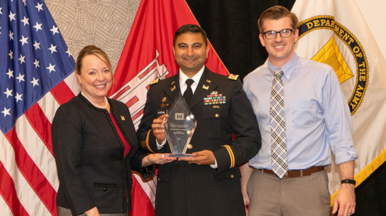 """Jill E. Stiglich, U.S. Army Corps of Engineers directorate of Contracting, presents the """"Best District/Center Award"""" to Lt. Col. Sonny B. Avichal, Nashville District commander, and Isaac Taylor, Branch Contracting chief, during the Society of American Military Engineers Federal Small Business Conference Excellence in Contracting Awards Program Nov. 21, 2019 in Dallas, Texas. (Photo by Angela Randall)"""