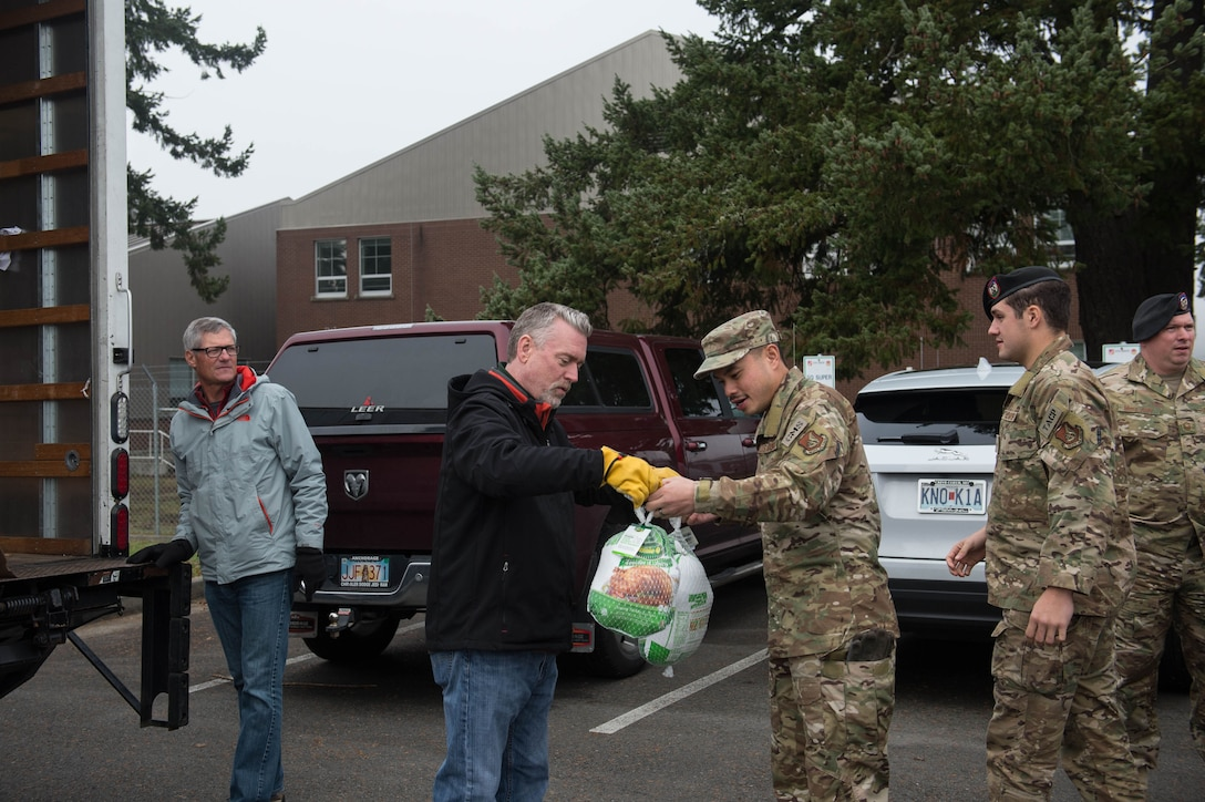 62nd Airlift Wing Airmen unload turkeys during Operation Turkey Drop, Nov. 21, 2019 at Joint Base Lewis-McChord, Wash. Local businesses donated over 250 turkeys to Team McChord Airmen this year.