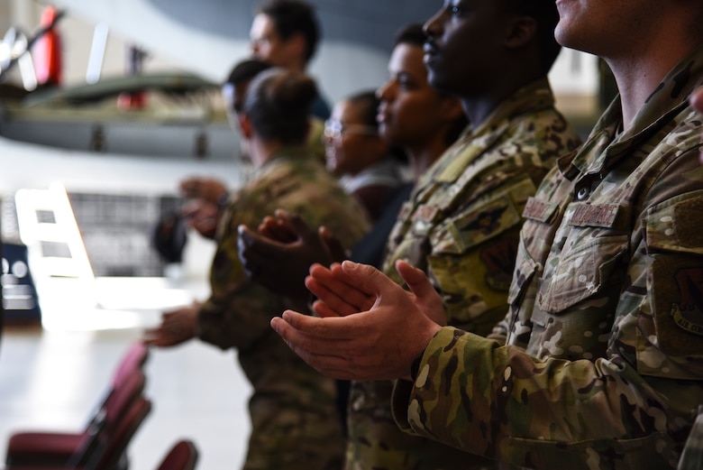 A photo of airmen applauding.