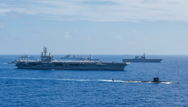 PHILIPPINE SEA (June 15, 2018) Ships from the Indian Navy, Japan Maritime Self-Defense Force (JMSDF) and the U.S. Navy sail in formation during Malabar 2018. Malabar 2018 is the 22nd rendition of the exercise and the first time it has been hosted off the coast of Guam. Malabar is designed to advance military-to-military coordination in a multinational environment between the U.S., Japan and Indian maritime forces. (U.S. Navy photo by Mass Communication Specialist 3rd Class Erwin Jacob V. Miciano)