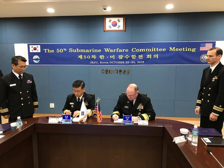 Rear Adm. Jimmy Pitts, Commander, Submarine Group 7, right, signs a memorandum with Rear Adm. Jung Il Shik, Commander, ROK Navy Submarine Force at the conclusion of the 50th semiannual Submarine Warfare Committee Meeting (SWCM) in Jeju, South Korea. Over the past 25 years, leaders of both the U.S. and ROK submarine forces have met consistently in recognition of the importance of combined submarine training and force integration. (U.S. Navy photo by LT Gregory Pavone)