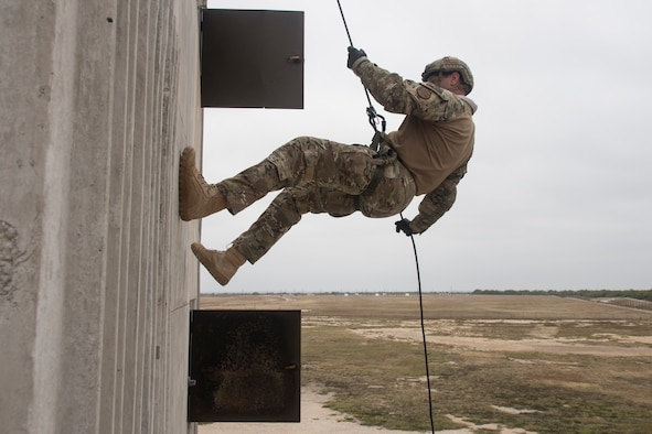 A U.S. Customs and Border Patrol Border Tactical agent rappels down Laughlin Air Force Base, Texas' fire drill tower Nov. 22, 2019. The Laughlin fire drill tower enabled the BORTAC and BORSTAR teams to train closer to home, and spend more time practicing than travelling to Hebbronville, Texas or laying a flatbed trailer over a cliffside ridge.