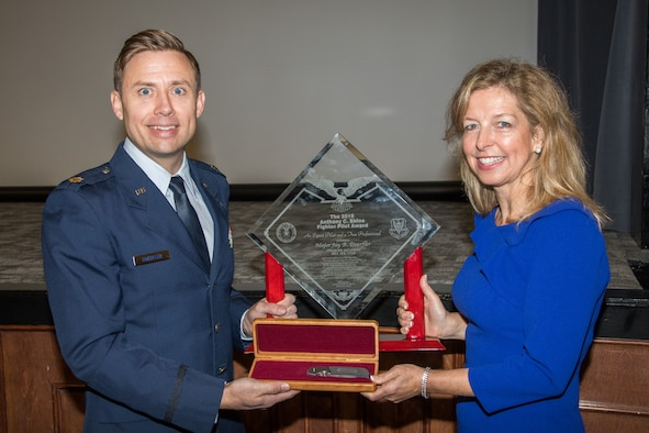 """Major Jay Burrell Doerfler addressed the participants to his award ceremony at Maxwell AFB's Wood Auditorium, Nov. 18, 2019. """"[Maj. Doerfler] is a sterling example of the caliber of excellence my father stood for: courage, integrity, excellence, and service,"""" said Shine. """"May you continue to demonstrate these qualities in all that you do."""""""