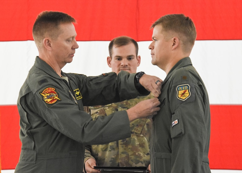 Col. Mike Schultz, commander of the 442d Fighter Wing, pins the Distinguished Flying Cross on Maj. John Tice, a flight commander with the 303d Fighter Squadron, during a ceremony at Whiteman Air Force Base, Mo., Nov. 2, 2019. Tice, a prior-enlisted Army combat engineer, earned the DFC during a combat mission flown in Afghanistan that resulted in 32 enemy combatants killed in action.
