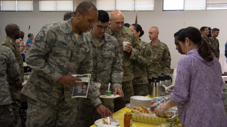 U.S. Air Force Airmen with Team MacDill stand in line to sample traditional Native American foods during a Native American Heritage Month Celebration, Nov. 21, 2019, at MacDill Air Force Base, Fla.  National Native American Heritage Month is held every November to recognize the contributions of American Indians to the development and growth of the U.S.