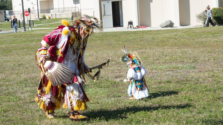 "Brian ""Blue Jay"" Littlejohn and his grandson Kyler, of the Cherokee nation, perform a traditional Cherokee dance during a Native American Heritage Month Celebration, Nov. 21, 2019, at MacDill Air Force Base, Fla.  The event featured traditional dance, songs and art provided by members of the Cherokee, Kiowa and Navajo Nations."