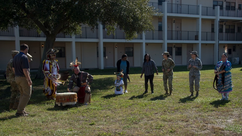 U.S. Air Force Airmen with Team MacDill participate in a traditional Cherokee dance during a Native American Heritage Month Celebration, Nov. 21, 2019, at MacDill Air Force Base, Fla. National Native American Heritage Month is held every November to recognize the contributions of American Indians to the development and growth of the U.S.