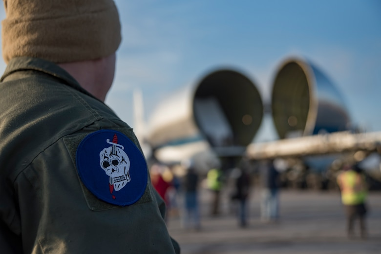 Photo of a 179th Airlift Wing member standing in front of the NASA Super Guppy