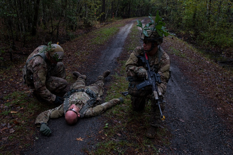 Students of the Air Force Ranger Assessment Course perform a simulated casualty search Nov. 15, 2019, at Moody Air Force Base, Ga. The course teaches students critical tasks such as land navigation, troop movements and shooting and maintaining weapons. Over the course of 19 days, the Ranger Assessment Course evaluates students to determine if they possess the knowledge, willpower and skill to attend Army Ranger School. (U.S. Air Force photo by Airman Azaria E. Foste