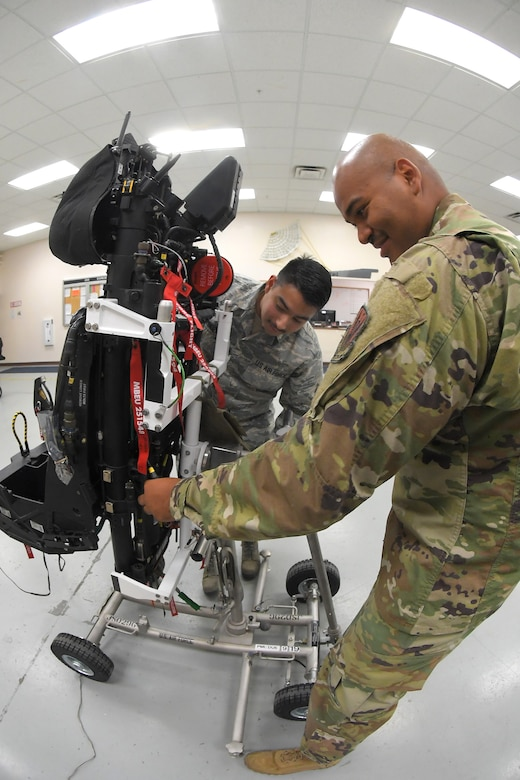 A photo of Airmen servicing F-35A ejection seat