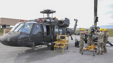 Soldiers conduct maintenance to keep birds in the sky