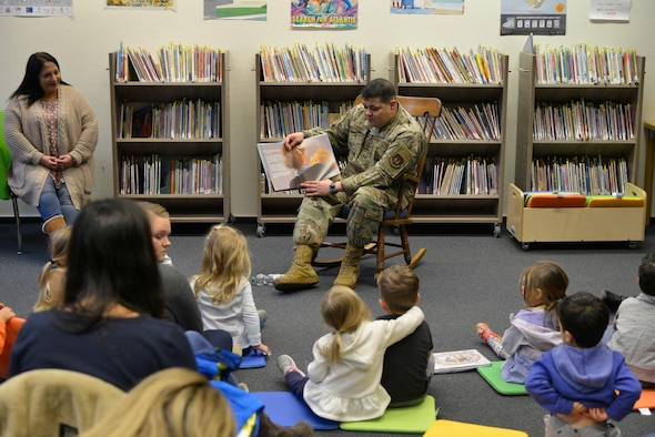 U.S. Air Force Chief Master Sgt. Ernesto J. Rendon, 86th Airlift Wing command chief, reads to children during Story Time at Ramstein Library, Ramstein Air Base, Nov. 21, 2019. Throughout December, each Story Time will celebrate a different holiday of the season. (U.S. Air Force photo by Airman 1st Class John R. Wright)