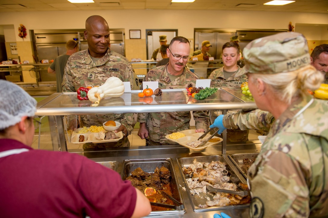 Service members receive their Thanksgiving meals