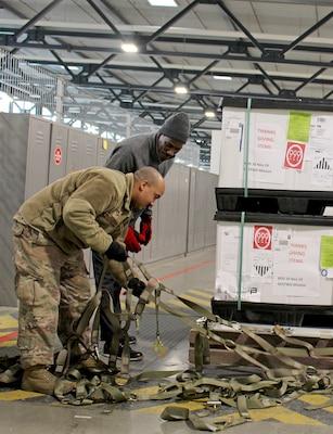 Food shipment pallets prepared for flight