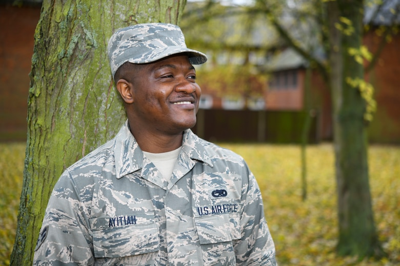 U.S. Air Force Airman 1st Class Micheal Ayitiah, 100th Maintenance Squadron crew chief, poses for a photo at RAF Mildenhall, England, Nov. 26, 2019. Ayitiah was 24 when he emigrated to where he thought he could achieve his dream– America. (U.S. Air Force photo by Senior Airman Alexandria Lee)