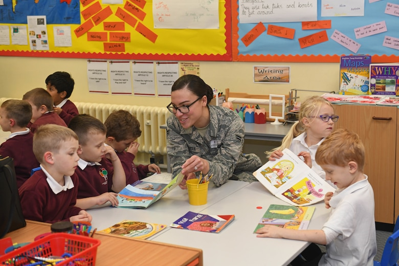 Airman 1st Class Antonia Herrera, 100th Air Refueling Wing Public Affairs broadcast journalist, reads to children at Houldsworth Valley Primary School in Newmarket, England, Nov. 26, 2019. Airmen from Team Mildenhall volunteered their time to go to the school to read books with the children and talk about their jobs on base. (U.S. Air Force photo by Senior Airman Luke Milano)