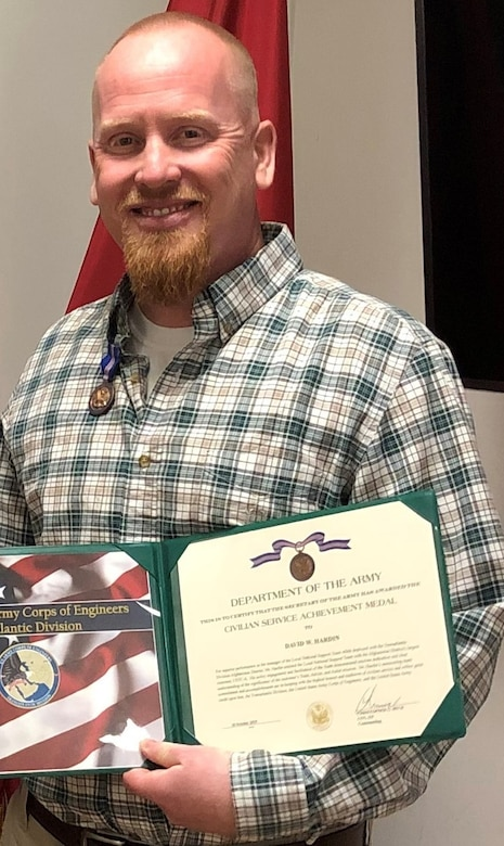 David Hardin receives an on the spot award with the Secretary of the Army Civilian Service Achievement Medal.