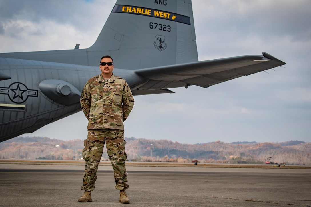 Master Sgt. Darrin Hazuka, a crew chief assigned to the 130th Aircraft Maintenance Squadron, poses for a portrait in front of a C-130H at McLaughlin Air National Guard Base, Charleston, W.Va. (U.S. Air National Guard Photo by Senior Airman Caleb Vance)