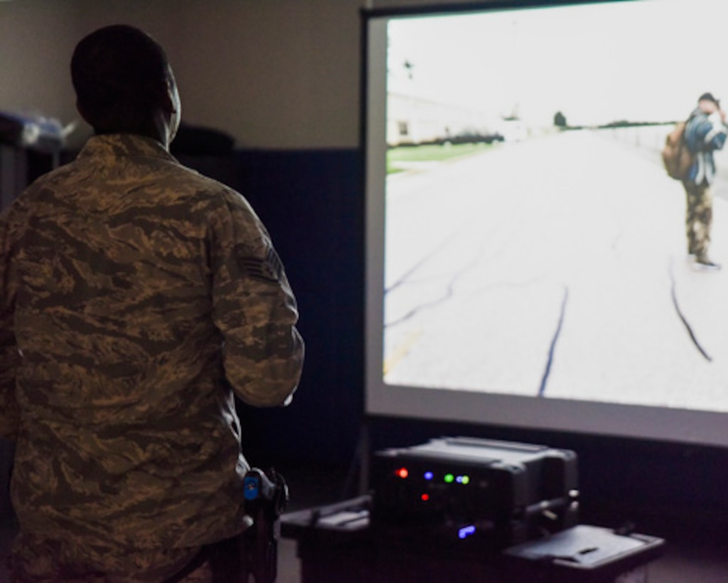 A Security Forces Airman, assigned to the 189th Airlift Wing, Arkansas Air National Guard, accomplishes use of force training on the simulator designed to supplement annual training in Little Rock, Ark., Nov. 3, 2019. The simulator offers 27 Guard-specific scenarios to ensure defenders' currency. (U.S. Air National Guard photo by Master Sgt. Jessica Roles)