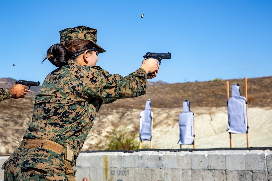U.S. Navy Hospital Corpsman 1st Class Vilma Rudolph, a corpsman with the 13th Marine Expeditionary Unit Command Element, engages her target with an M9 pistol during a qualification range at Marine Corps Base Camp Pendleton, Calif., Nov. 26, 2019. The annual range test Marines on their marksmanship with a service pistol and qualifies them to stand duty in support of MEU operations. The California-based 13th MEU is scalable, and highly capable Marine Air-Ground Task Force, designed to rapidly respond to a wide range of military operations globally.