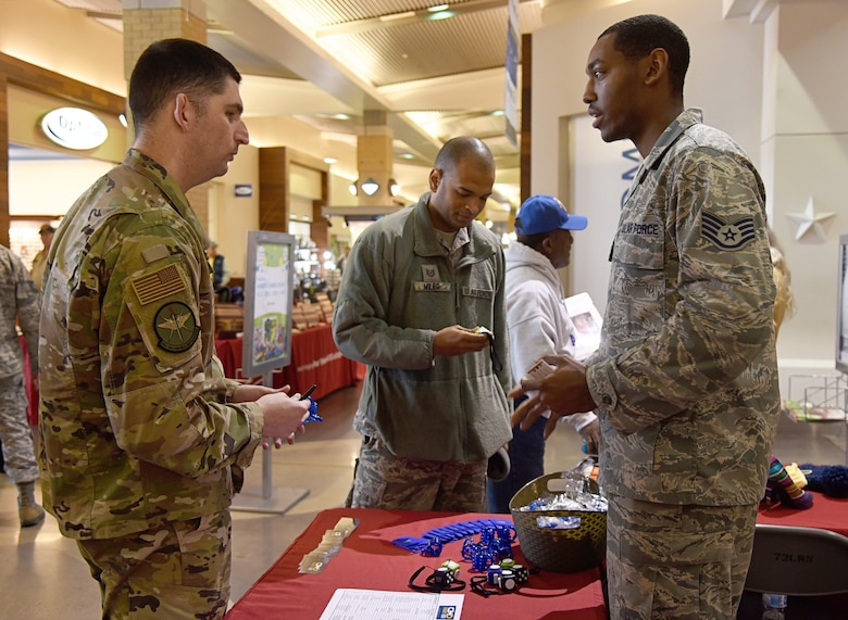 An image of two Airmen connecting through Tinker Hobby Hub, a new platform to link up Airmen through similar interests