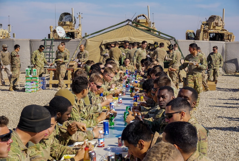 Soldiers assigned to 3rd Cavalry Regiment enjoy Thanksgiving dinner on Fire Base Saham, Iraq, Nov. 20, 2018. This year, Army Central Command plans to feed about 50,000 troops, government civilians, contractors and coalition partners across its area of operations. (Photo Credit: Capt. Jason Welch)