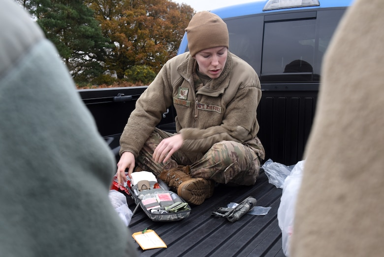 Tech. Sgt. Brittani McClure, assigned to the 423rd Medical Squadron at Royal Air Force Alconbury, England, prepares a medical kit for a joint exercise hosted by Suffolk Lowland Search and Rescue in Thetford, England, Nov. 23, 2019. U.S. Air Force Medical Airmen participating in the exercise had the opportunity to enhance medical readiness through an interactive scenario. (U.S. Air Force photo by Airman 1st Class Rhonda Smith)