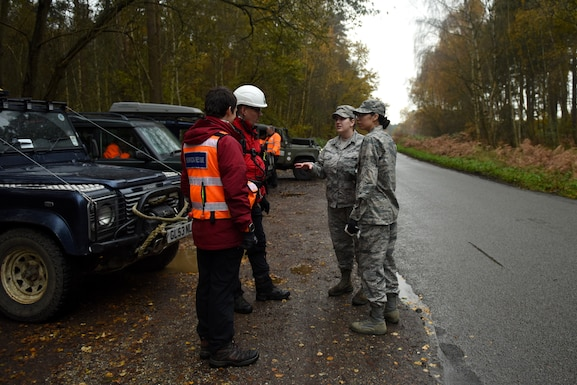 Liberty Wing Airmen brief volunteers during a joint search and rescue event hosted by Suffolk Lowlands Search and Rescue in Thetford, England, Nov. 23, 2019. The SuLSAR event allowed U.S. Air Force medics the opportunity to build a stronger partnership working alongside emergency responders. (U.S. Air Force photo by Airman 1st Class Rhonda Smith)