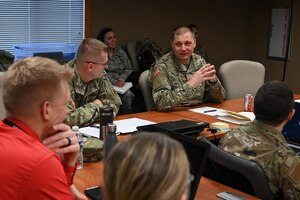 Maj. Gen. Al Dohrmann, the North Dakota adjutant general, right, explains objectives at a meeting of his employee advisory board at the North Dakota Air National Guard Base, Fargo, N.D., Nov. 15, 2019.