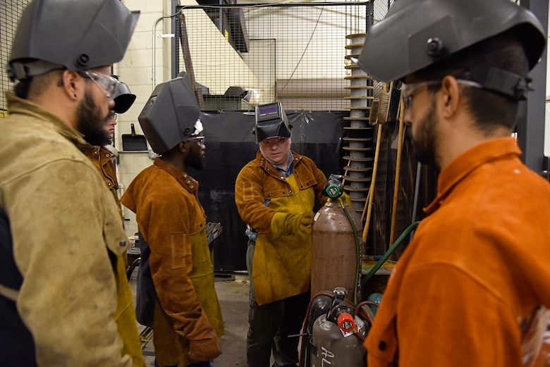 An image of Adam Dumstorf teaching an airframe welding lesson to students at MetroTech in Oklahoma City.