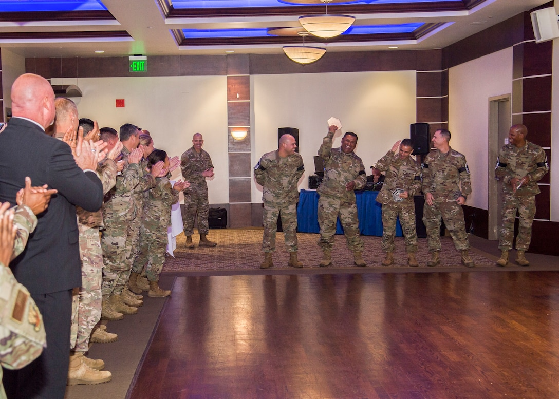 Newly-selected chief master sergeants celebrate their promotion during the chief master sergeant release ceremony at MacDill Air Force Base, Fla., Nov. 25, 2019.