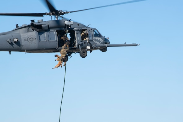 A photo of Airmen flying in a helicopter