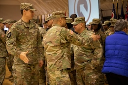 "1st Theater Sustainment Command (TSC) Soldiers shake hands and say goodbye to Master Sgt. Edgar Ocegueda, maintenance management branch NCOIC, 1st TSC at a deployment ceremony Nov. 26, 2019 at Sadowski Center on Fort Knox, Ky. Ocegueda will be deploying with the Strategic Operations and Plans (SOaP) ""Blue Team"" to the U.S. Central Command (CENTCOM) area of operations."