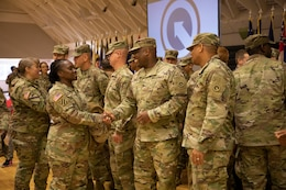 "Sgt. Maj. Gail Lashley, senior logistician, G-4, 1st Theater Sustainment Command (TSC), shakes hands with Sgt. 1st Class William Bell, maintenance management NCO, Support Operations (SPO), Operational Contracting Support, 1st TSC, at a deployment ceremony at Sadowski Center on Fort Knox, Ky. Bell will be deploying with the Strategic Operations and Plans (SOaP) ""Blue Team"" to the U.S. Central Command (CENTCOM) area of operations."
