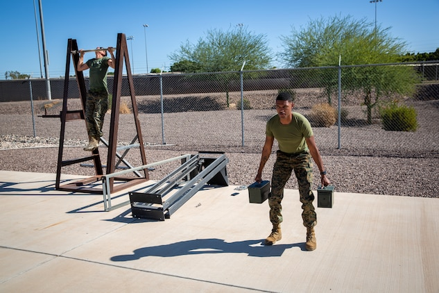 U.S. Marines with Station Communications Strategy and Operations, Marine Corps Air Station (MCAS) Yuma, engage in a physical fitness workout in order to prepare themselves for the combat fitness test (CFT) on MCAS Yuma, Oct. 22, 2019. A CFT is composed of an 880-yard sprint, ammo can presses for two minutes, and performing a times event, the maneuver-under-fire, in which Marines conduct combat related tasks. (U.S. Marine Corps photo by Lance Cpl. Andres Hernandez)