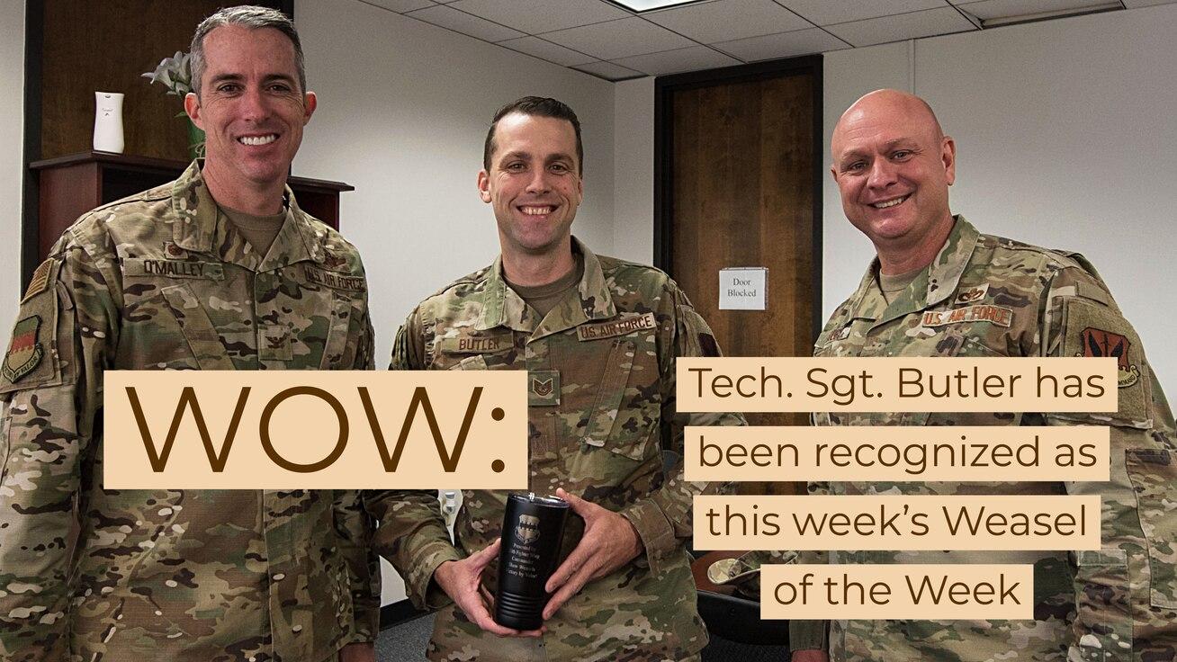 Photo of Tech. Sgt. Butler receiving Weasel of the Week award.
