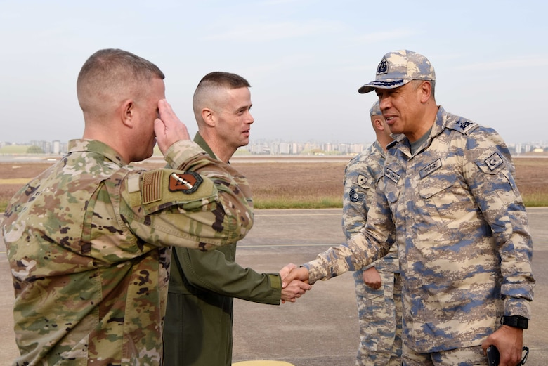 U.S. Air Force Col. Randy Oakland, 39th Air Base Wing commander, and U.S. Air Force Chief Master Sgt. Michael Roxberry, 39th ABW command chief, welcome Brig. Gen. Ümüt Yıldız, Turkish General Staff chief of foreign affairs, during the Defense and Economic Cooperation Agreement inspection at Incirlik Air Base, Turkey, Nov. 25, 2019. The DECA annual visit doesn't administer a pass or fail grade, but rather serves to strengthen the bilateral relationship between Turkey and the United States. The agreement, established in 1980, sets some operating rules for the bilateral relationship. (U.S. Air Force photo by Tech. Sgt. Jim Araos)