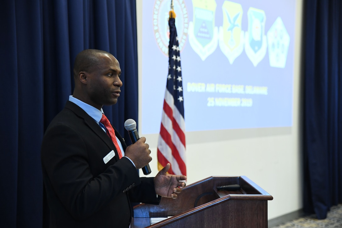 Evans Armantrading, vice chair of the Central Delaware Chamber of Commerce Military Affairs Committee, introduces Col. Joel Safranek, 436th Airlift Wing commander, during the State of the Base on Dover Air Force Base, Del., Nov. 25, 2019. The CDCC Military Affairs Committee hosts the State of the Base each year to inform the community and civilian leaders of the base's operations and economic impact. (U.S. Air Force photo by Senior Airman Eric M. Fisher)