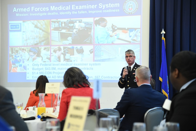 Col. Louis Finelli, Armed Forces Medical Examiner System director, speaks during the State of the Base on Dover Air Force Base, Del., Nov. 25, 2019. State of the Base is an annual event that provides community leaders an opportunity to learn more about Dover AFB's operations and future plans. (U.S. Air Force photo by Senior Airman Eric M. Fisher)