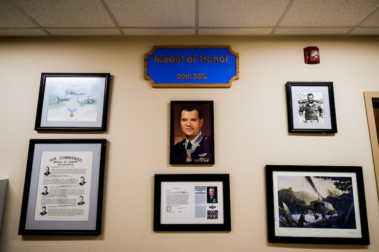 Depicted is the Medal of Honor dedication wall inside the 20th Special Operations Squadron building at Cannon Air Force Base, N.M., Nov. 26, 2019. The wall seeks to immortalize one of the squadrons most decorated members, Col. James Fleming, Medal of Honor recipient. (U.S. Air Force photo by Senior Airman Marcel Williams)
