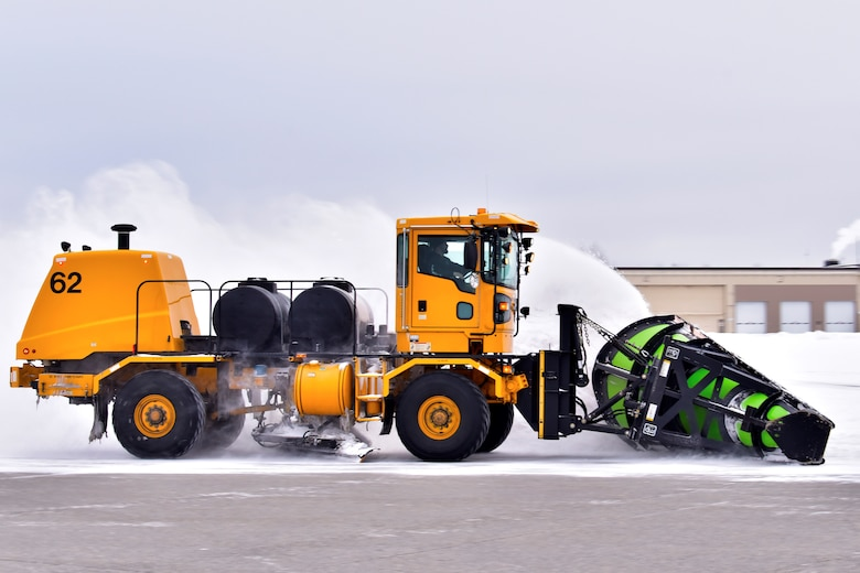A 354th Civil Engineer Squadron pavements and construction equipment operator plows snow from the flight line at Eielson Air Force Base, Alaska, Nov. 26, 2019. The Airmen at the snow barn keep the infrastructure of the base as safe as possible by removing snow and ice in order to maintain a mission-ready status. (U.S. Air Force photo by Senior Airman Beaux Hebert)