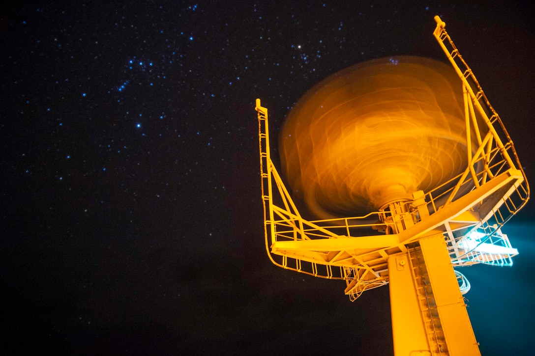 A radar with the night sky in the background.
