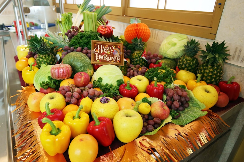 A large group of fruit and vegetables displayed on a table.