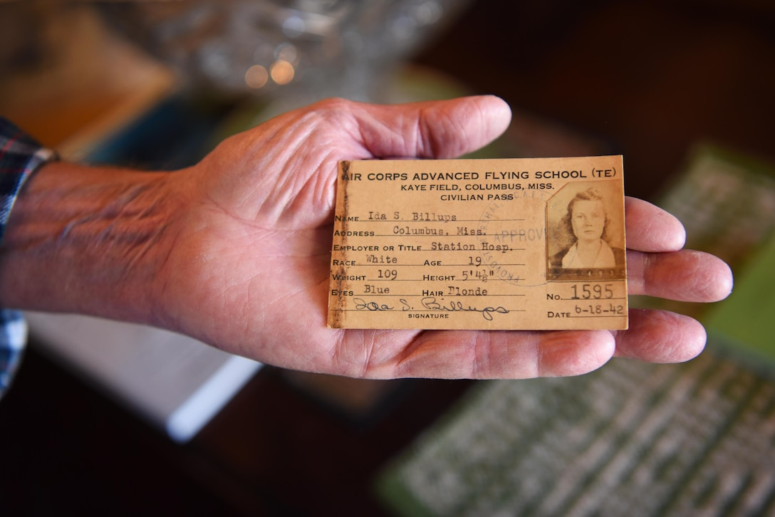 Rufus Ward, honorary commander of the 43rd Flying Training Squadron, holds up an Identification Card of his mother when she was a civilian worker on Columbus Army Air Field, Nov. 20, 2019, in Columbus, Miss. Ida Ward worked at the Kaye Army Air Field Station Hospital on Columbus Army Air Field during World War II and volunteered for the Civil Air Patrol to fly in a Piper Cub. (U.S. Air Force photo by Airmen 1st Class Jake Jacobsen)